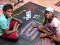 Kids playing Walkabout game mat up in Darwin, NT